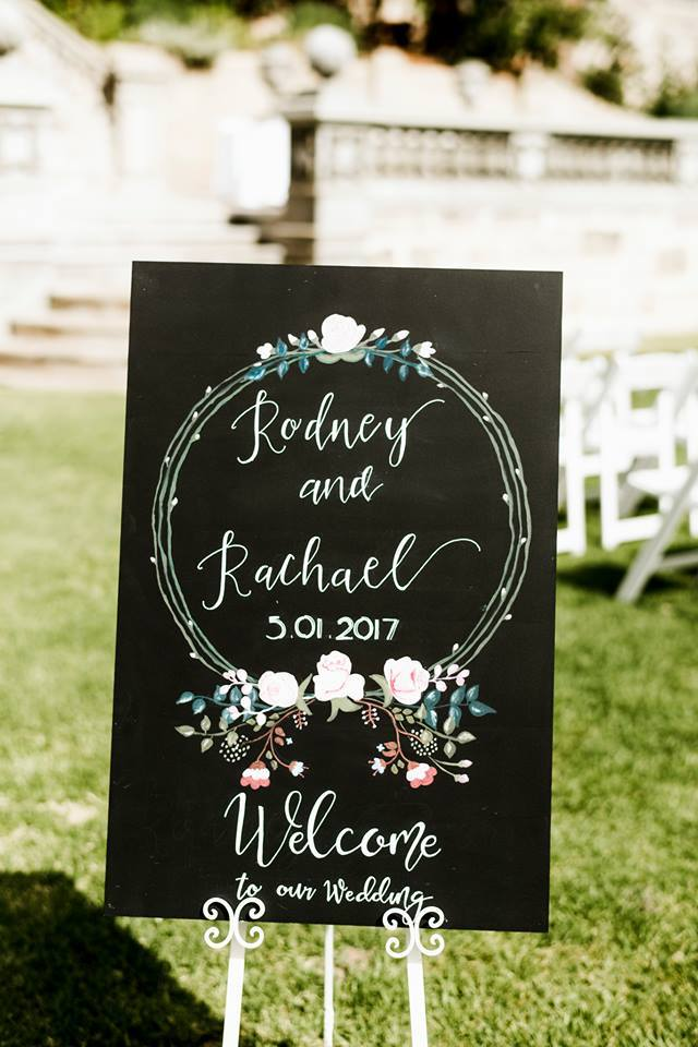 blackboard welcome sign with handpainted florals