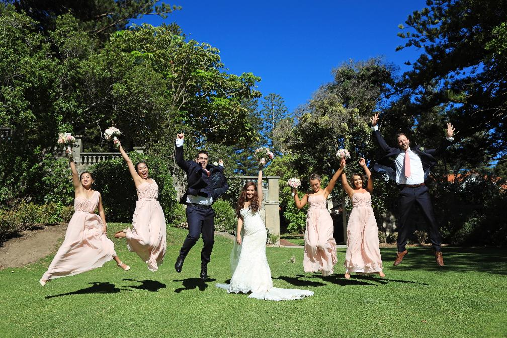 bridal party jumping in air