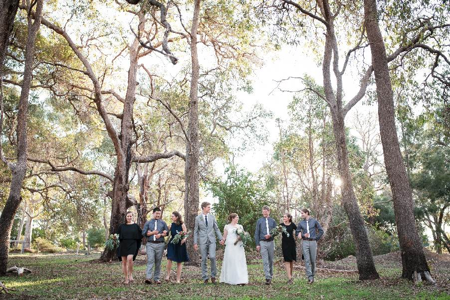 bridal party with tall trees