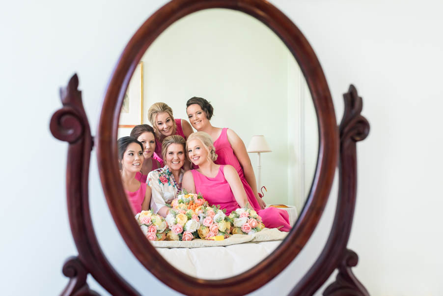 bride with bridesmaids reflection in mirror